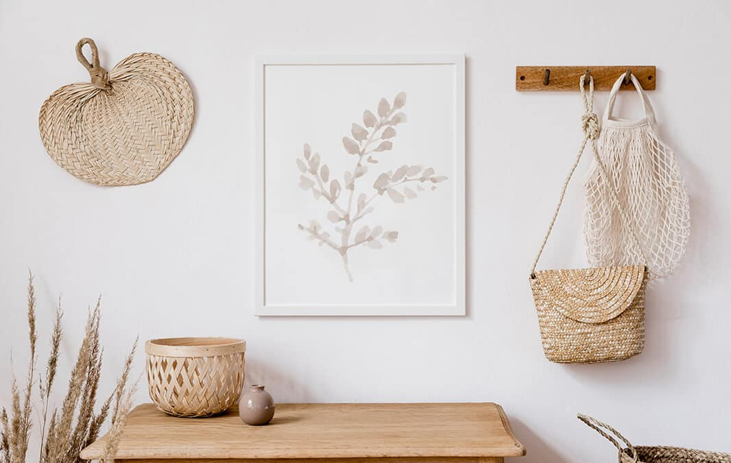 Wood table with a small basket in a white wall with a white frame