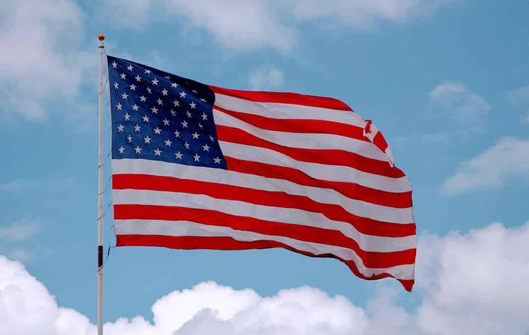 American flag waving in a blue sky
