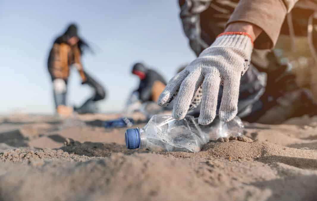 Hand Picking up plastic bottle